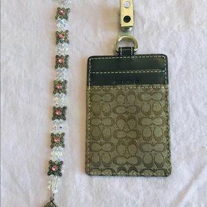 Coach card holder and decorative bracelet